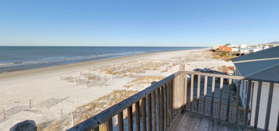 View of the beach from a porch at Cape San Blas